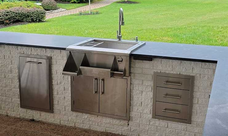 A beautifully finished outdoor sink and outdoor kitchen